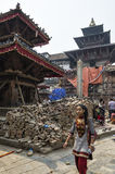 Unidentified vistors and tourists around the damaged street and building in Bhaktapur after major earthquake in 2015. Stock Photo