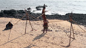 Unidentified Wandering tightrope walker playing on the beach. Goa, India – February 24, 2016: Unidentified Wandering tightrope walker playing on the beach stock video