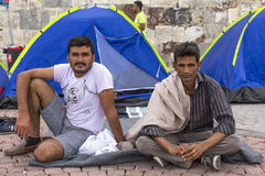 Unidentified war refugees near the tents. More than half are migrants from Syria Stock Images