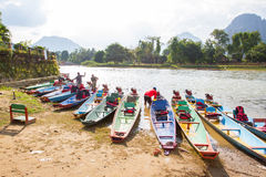 Unidentified washing boat. VANG VIENG, LAOS - OCT 18: unidentified washing boat on oct 18, 2015, in Vang Vieng, Laos. Vang Vieng is a tourism-oriented town in Stock Photos