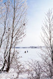Unidentified winter fishermen on frozen lake Royalty Free Stock Photo