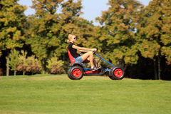 Unidentified woman in a buggy in the park in Mezhyhirya, Ukraine Royalty Free Stock Photos