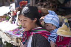 An unidentified woman carries her baby in traditional sling January 5, 2009 in La Paz, Bolivia. Stock Photos