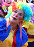 Unidentified Woman Clown with colorful wig posing at Orange Blossom Carnival stock photo