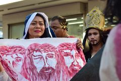 Unidentified woman crying in pity approach role playing Jesus Christ. San Pablo City, Laguna, Philippines - April 14, 2017: Unidentified woman crying in pity Royalty Free Stock Photo