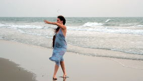Unidentified woman dancing on the beach. Goa, India – February 15, 2016: Unidentified woman dancing on the beach stock video footage