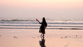 Unidentified woman dancing with fan on the beach. Goa, India - February 23, 2016: Unidentified woman dancing with fan on the beach stock video