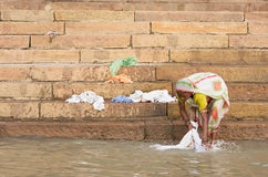 Unidentified woman doing laundry banks of the Ganges river Royalty Free Stock Images
