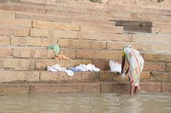 Unidentified woman doing laundry banks of the Ganges river Royalty Free Stock Image