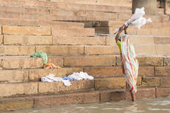 Unidentified woman doing laundry banks of the Ganges river Royalty Free Stock Photo