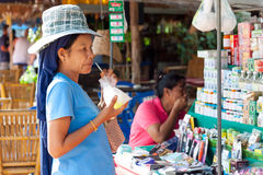 Unidentified woman drinking juice on the local market in Khao Lak. Royalty Free Stock Photo