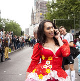 Unidentified woman during Gay pride parade. BERLIN, GERMANY - JUNE 21, 2014:Christopher Street Day.An unidentified sexy woman at the gay pride parade, talk on Royalty Free Stock Images