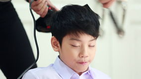 Unidentified woman hairdryer drying hair asian boy, beauty and fashion.  stock footage