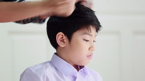 Unidentified woman hairdryer drying hair asian boy, beauty and fashion.  stock video footage