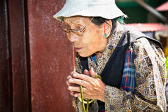 Unidentified woman  with her mala beads praying in Bouddanath St Stock Photos