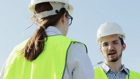 Unidentified Woman And A Male Engineer A Project Foreman stock footage