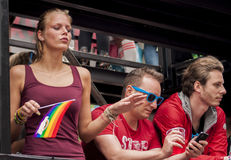 Unidentified woman with rainbow flag. BERLIN, GERMANY - JUNE 21, 2014:Christopher Street Day.Crowd of people participate in the parade celebrates gays, lesbians Stock Photography