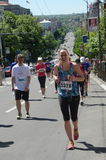 An unidentified woman runs in 29th Belgrade Marathon on April 16, 2016 in Belgrade, Serbia Stock Images