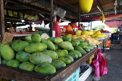 Unidentified woman sell tropical fruits in the fruit market Stock Photography