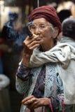 An unidentified woman smoking a cheroot cigar in market at bagan Royalty Free Stock Images