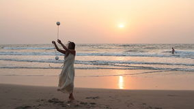 Unidentified woman spinning poi on the beach. stock footage