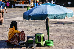Unidentified woman at a street in Marrakesh. Royalty Free Stock Image
