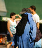 Unidentified woman at a street in Marrakesh. Royalty Free Stock Images