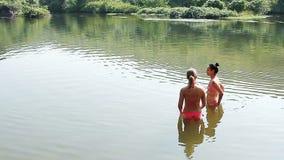 Unidentified woman swimming in the Arambol sweet lake. Goa, India – February 26, 2016: Unidentified woman swimming in the Arambol sweet lake stock video