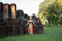 Unidentified woman with Thai dress at Phanomwan Historical Park Stock Photo