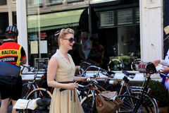 Unidentified woman in vintage style clothes with bicycle on Twee royalty free stock photography