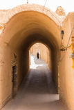 An unidentified woman walks down the streets of Yazd Royalty Free Stock Photography