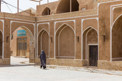 An unidentified woman walks down the streets of Yazd Royalty Free Stock Images