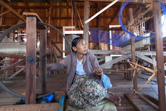 Unidentified woman was weaving silk fabric by method and machine traditional Royalty Free Stock Photos