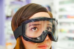 Unidentified woman wearing ski glasses protection, in optical, in a blurred background Royalty Free Stock Photos