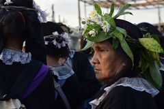 Unidentified Women penitents in garb and crown of bitter herbs carrying angel figurine scepter standing on the churchyard on Lente. San Pablo City, Laguna royalty free stock images