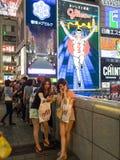 Unidentified women selfy at Shinsaibashi Shopping arcade. OSAKA, JAPAN - JUNE 29, 2014 : Unidentified people shop at Shinsaibashi Shopping arcade. Shinsaibashi Royalty Free Stock Images