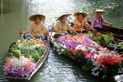 Unidentified women vendor fruits and flowers. Stock Photos