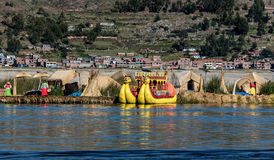 Unidentified women welcome tourist on the lake Titicaca in Puno, Stock Images