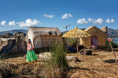 Unidentified women welcome tourist on the lake Titicaca in Puno, Royalty Free Stock Image