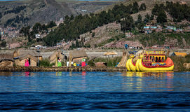 Unidentified women welcome tourist on the lake Titicaca in Puno, Stock Photography