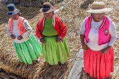 Unidentified women welcome tourist on the lake Titicaca in Puno, Royalty Free Stock Images