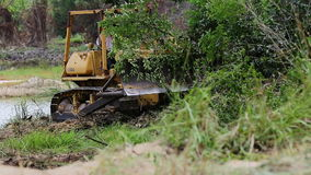 Unidentified worker control Bulldozer to excavator grader removing the ground stock video footage