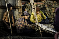 Unidentified worker rest in fisherman boat Royalty Free Stock Images