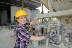 Unidentified worker welding metal frame in construction site Royalty Free Stock Photo