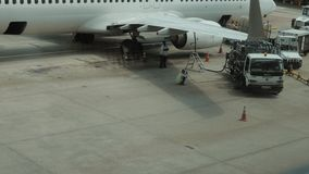 Unidentified Workers Of Airport working near airplane. In 4K stock video