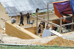 Unidentified workers  building a house with clay and stones on December 7, 2011 in mountainous and rural district of Dong Van, Royalty Free Stock Images