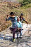 Unidentified workers, carry pilgrims to the Jain temples. Palitana, India - March 6, 2016: Unidentified workers, carry pilgrims to the Jain temples on top of royalty free stock photos
