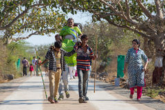 Unidentified workers, carry pilgrims to the Jain temples. Palitana, India - March 6, 2016: Unidentified workers, carry pilgrims to the Jain temples on top of royalty free stock photo