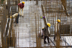 Unidentified workers are employed in construction overhead metro in Bangalore Royalty Free Stock Photo