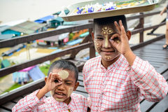 Unidentified young asian boy with thanaka powder on face Stock Photography